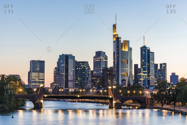 July 3, 2019: Illuminated bridge over river against clear sky during sunset in Frankfurt- Germany