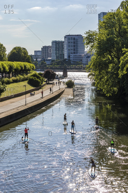 July 3, 2019: High angle view of people paddleboarding on river in Frankfurt- Germany