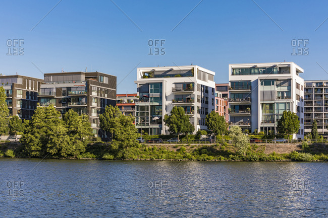 Modern apartments in front of river against clear sky at Frankfurt- Germany