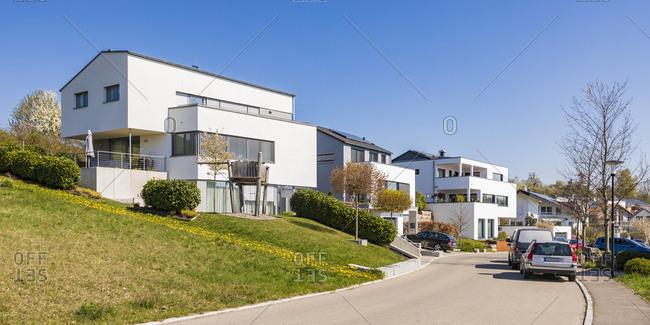 April 18, 2019: Residential buildings by street against clear blue sky on sunny day- Dettenhausen- Tubingen- Germany