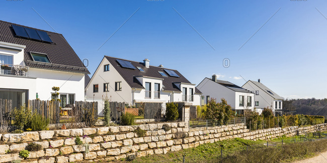 Houses with solar panels on roof against clear blue sky- Baden-Wurttemberg- Germany