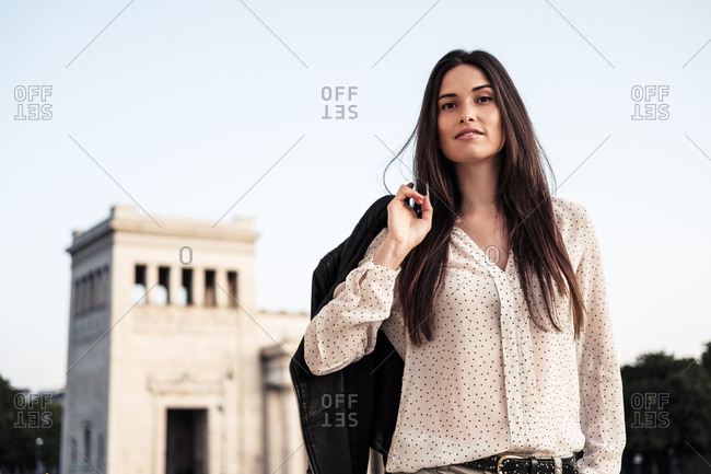Portrait of young woman with long brown hair- Munich- Germany
