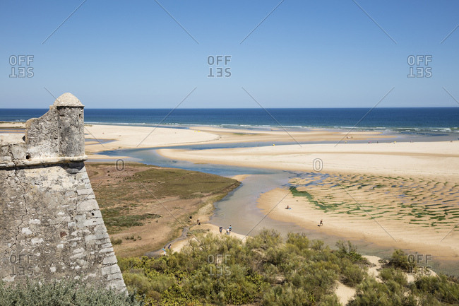 Scenic view of Ria Formosa against clear blue sky- Portugal