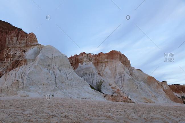 Rocky sandstone at Atlantic Coast against sky during sunset- Algarve- Portugal