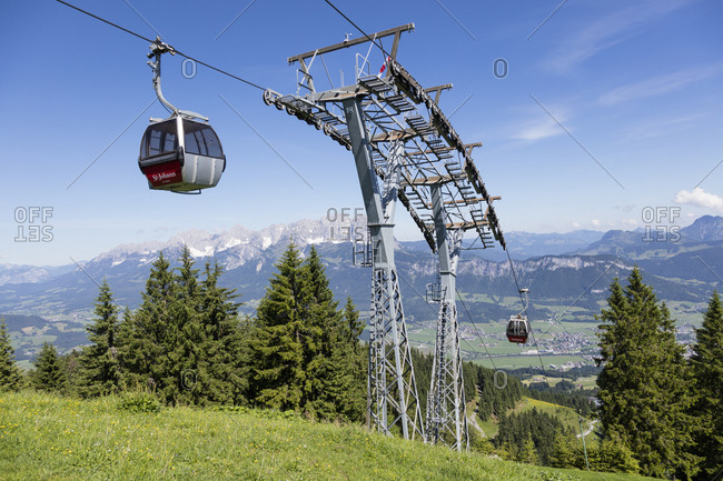 June 24, 2019: Overhead cable cars at Harschbichlbahn against sky- Kitzbuhel- Tyrol- Austria