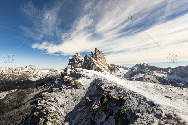 Seceda peak and mountains covered with snow against sky- Italy