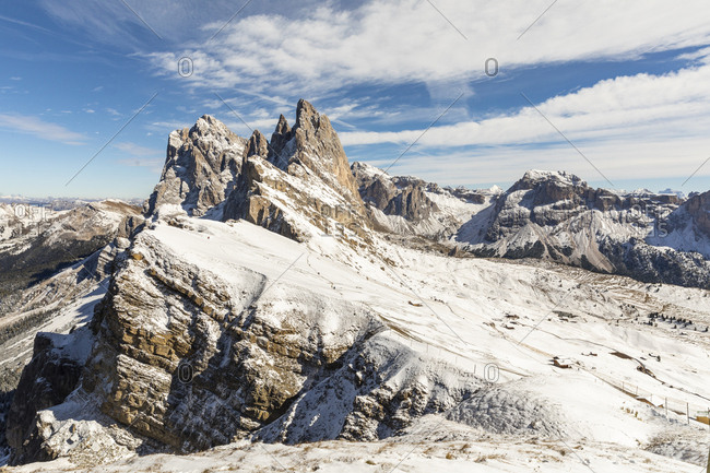 Scenic view of Seceda peak and mountains against sky during winter- Italy