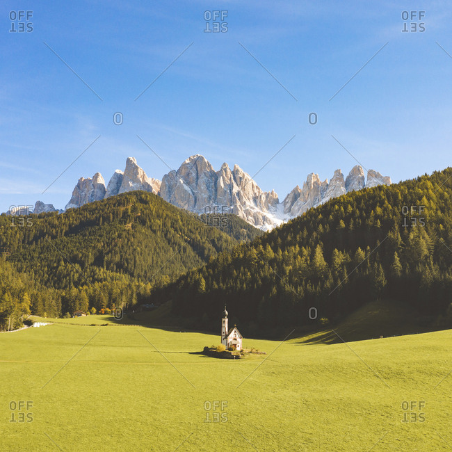 Scenic view of Odle mountain peaks and Chiesa di Santa Maddalena against sky- Italy