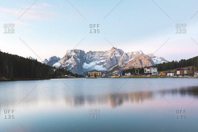 Scenic view of Lake Misurina and mountains against sky during sunrise- Italy