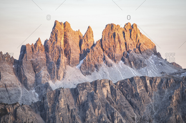 Scenic view of mountain peaks in Italy against sky during sunset- Italy