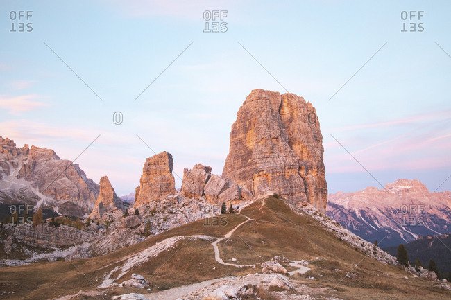 Scenic view of Cinque Torri and mountain range against sky during sunset- Italy