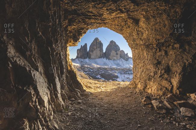 Scenic view of Tre Cime di Lavaredo seen through cave- Italy