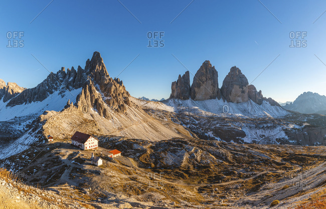 Scenic view of Tre Cime di Lavaredo and Mount Paterno against clear blue sky- Italy
