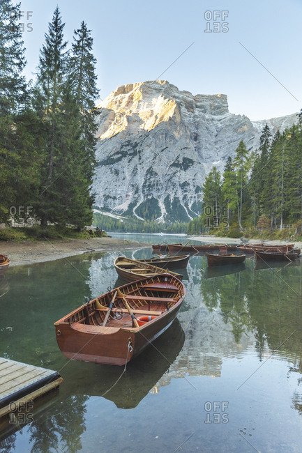 Rowboats moored at Braies lake against mountain- Italy