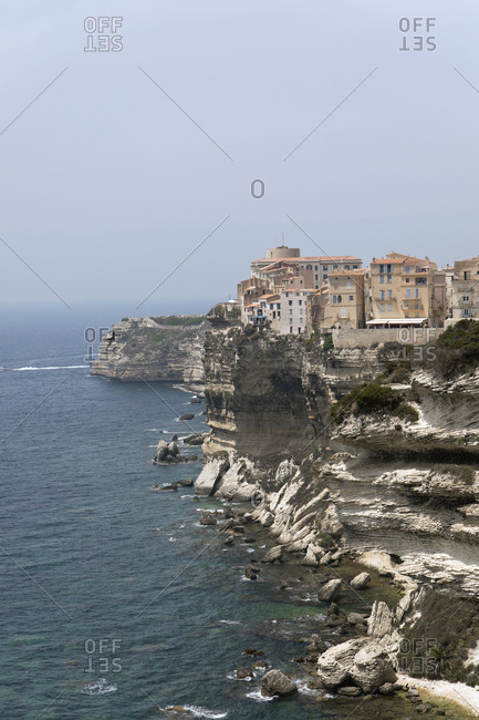 July 7, 2019: Old town Bonifacio on White Limestone Cliffs against clear sky at Corsica- France