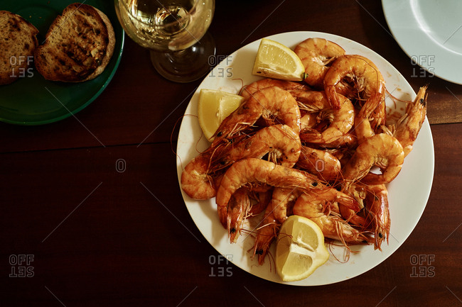 Cooked shrimp with white wine, butter and lemon. Summer lunch at home. Portuguese cuisine