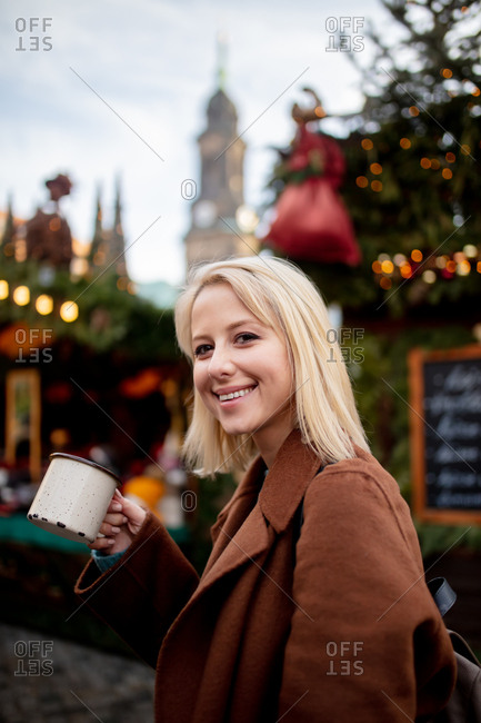Blonde woman with mulled wine at the Christmas market in Dresden, Germany