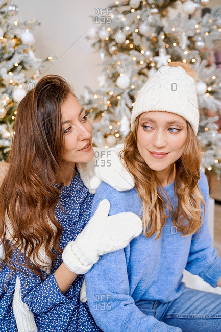 Two women dressed in blue and winter gear