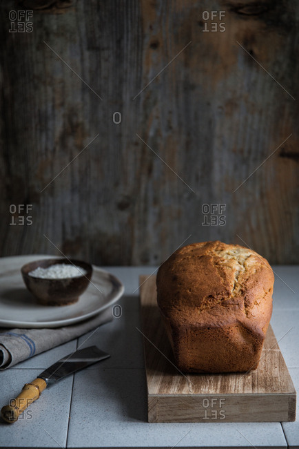 A just backed golden brown pound cake on a wooden board