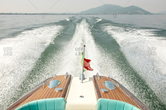 Trails in the water from a luxury speed boat on Iseo Lake, Italy