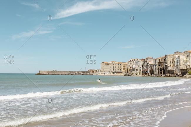 Beach scene on the coast of Cefalu, Sicily, Italy