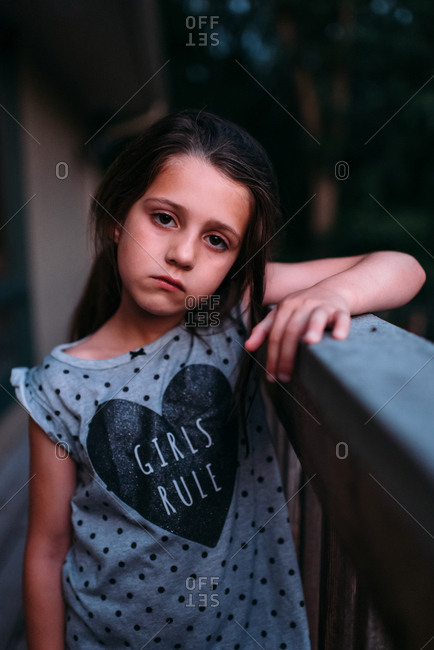 Portrait of a girl on a deck at dusk
