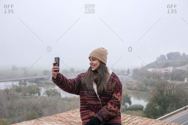 40 year old Caucasian woman takes a selfie on a cloudy day