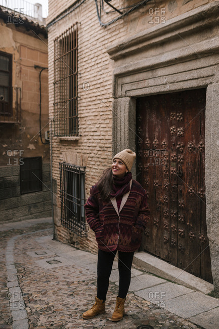Young tourist woman walking through an ancient city of Spain