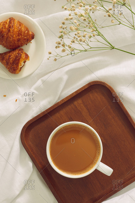 Top view of a cup of fresh coffee and breakfast
