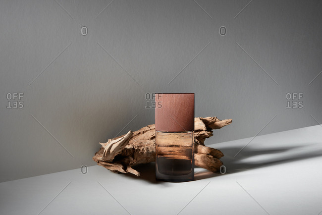 Fragrance perfume bottle mockup on wooden background