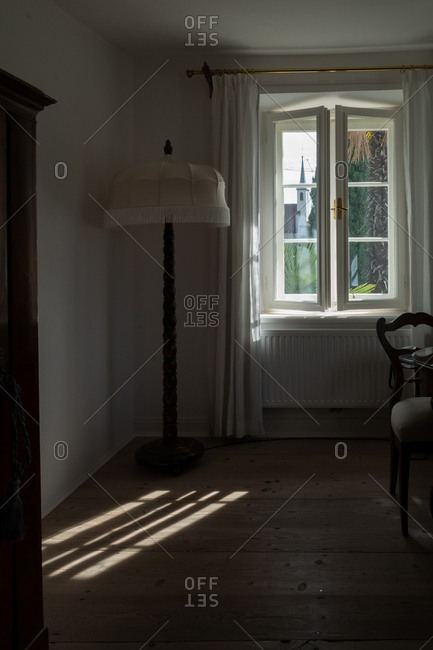 Floor lamp in corner by window in a home in Meran, South Tyrol, Italy