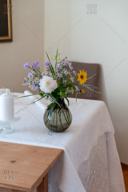 Colorful flower arrangement on a table with white tablecloth