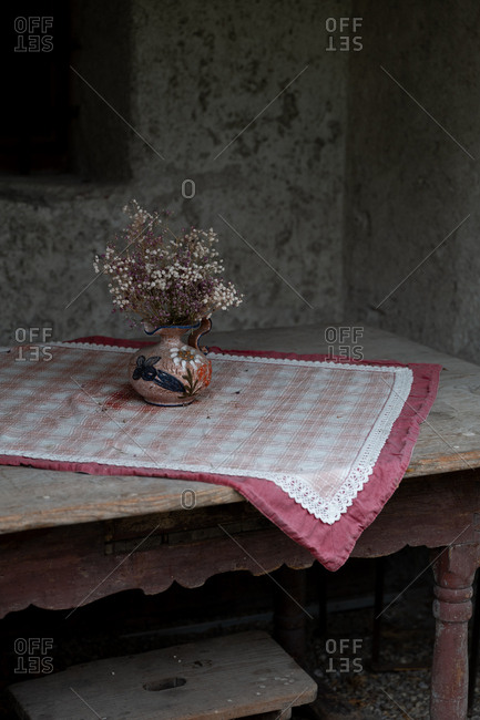 Small flower arrangement on a rustic table in an old home, Meran, South Tyrol, Italy