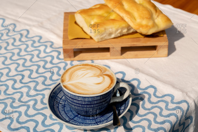 Cappuccino and focaccia on an outdoor table