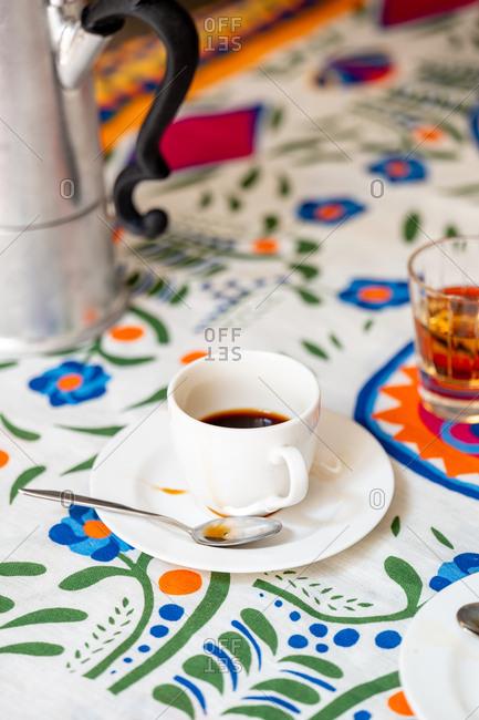 Coffee amaro beside a moka pot