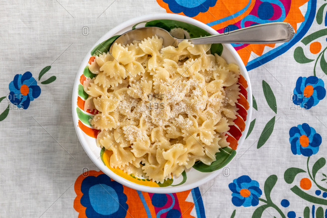 Bowtie pasta in a blue bowl