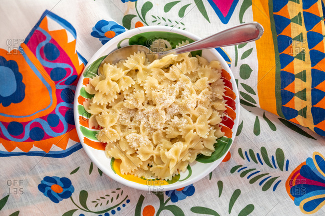 Overhead view of farfalle pasta in a blue bowl