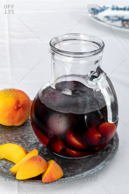 Peach sangria in a pitcher