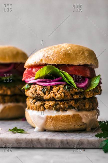 Sweet Potato Chickpea Burgers on a marble background