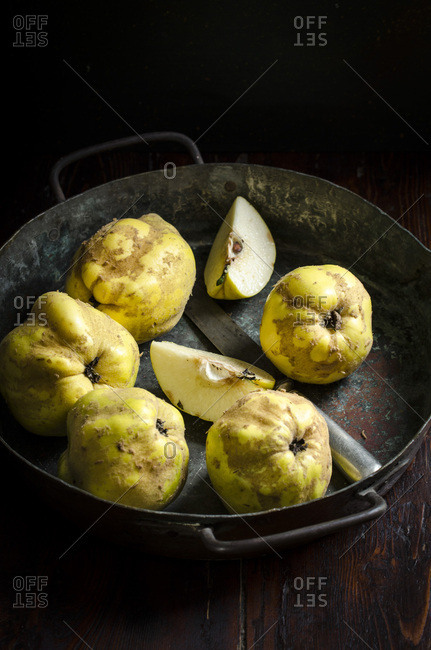 Quinces in a tin tray