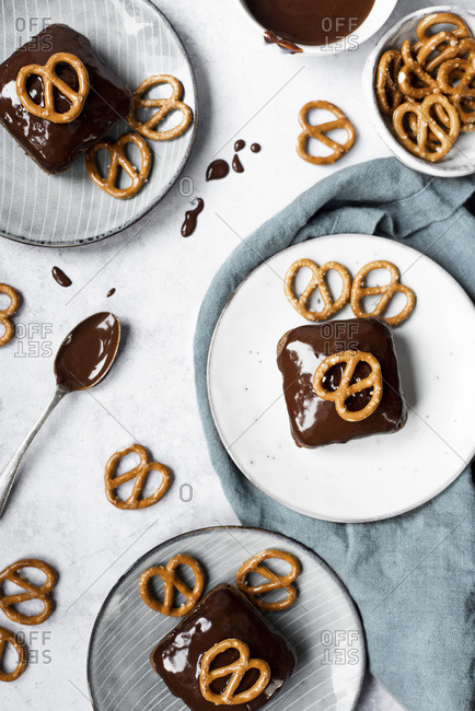 Peanut Brownies Topped With Dark Chocolate Ganache And Pretzels