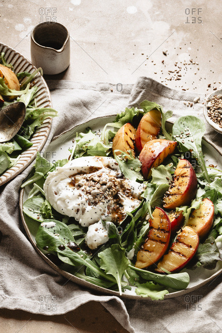 Summer salad with peaches and burrata