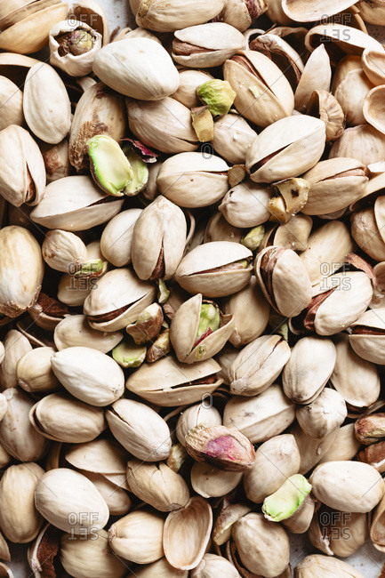 Raw opened pistachios in group