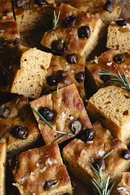 Delicious olive and rosemary pumpkin focaccia closeup