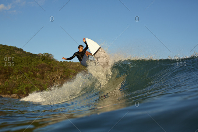 Male surfer riding ocean wave