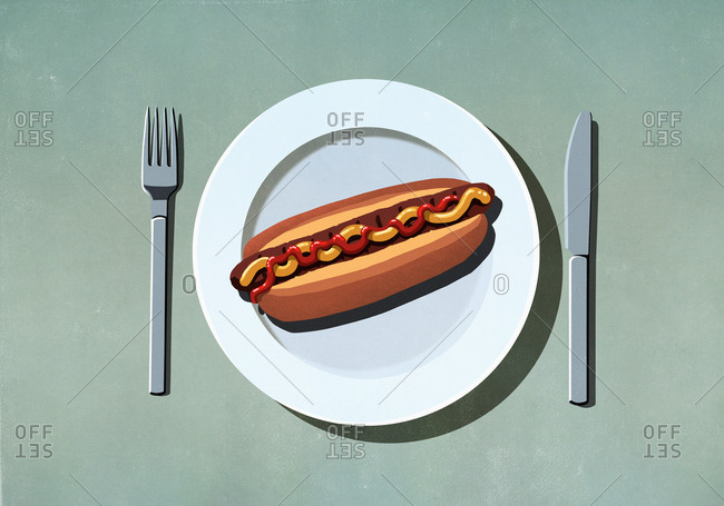 Hot dog with ketchup and mustard on plate