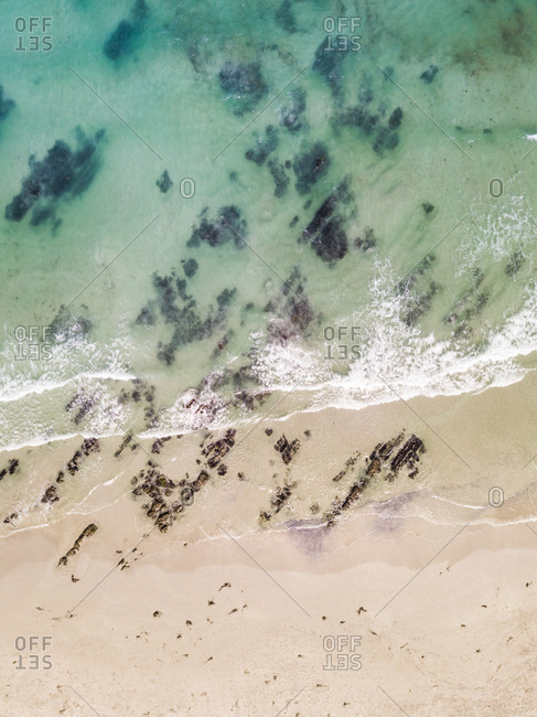 Abstract aerial view of an empty beach at Cape Town, South Africa.