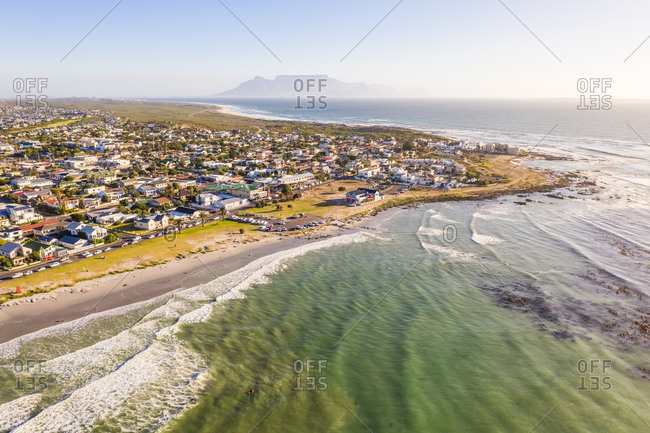 Aerial view of Melkbosstrand coastal city during sunset, South Africa.