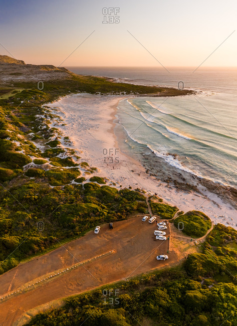 Aerial view of cars parked near Scarborough Beach during sunset, South Africa.