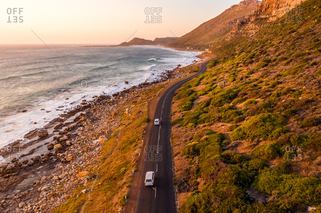 Aerial view of road crossing Scarborough Beach at sunset, South Africa.
